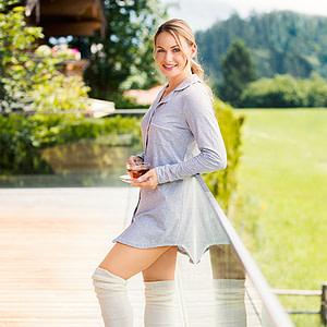 Lady standing wearing Jentschura Alkaline Stockings
