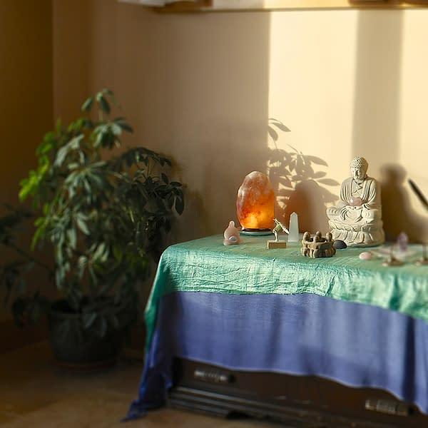 Himalayan Salt lamp On Buddist table